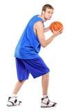 Verticale intégrale d'un joueur de basket Photo stock