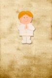 Verticale kaart eerste kerkgemeenschap, grappige blonde jongen Stock Foto