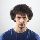 Verticale triste de jeune homme Image libre de droits