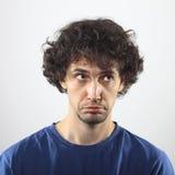 Verticale triste de jeune homme Photographie stock libre de droits