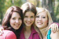 Verticales de trois filles Photos libres de droits