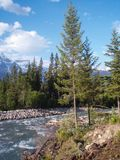 Vertically exposed scenic mountain view from the river bank in M stock photos