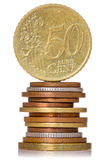 Vertically stacked coins Stock Images