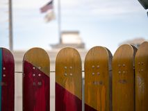 Vertically standing red and yellow skateboards hung as if they w royalty free stock photos