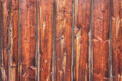 Vertically tiled stained wood wall texture background.  royalty free stock images