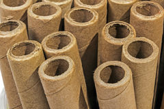 Verticaly Stacked  Collection of Cardboard Packaging Tubes Royalty Free Stock Photos