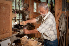 Vertiente y carpintero de la vendimia Fotografía de archivo