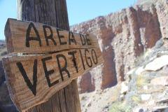 Vertigo area. Right at 6000 feet a sign warning that you will experience dizziness or vertigo. Located in the Quebrada de Humahuaca in Jujuy - Argentina Stock Images