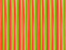 Vertikale Linien der roten grünen hölzernen Beschaffenheit extrahieren den symmetrischen Hintergrund Lizenzfreies Stockbild