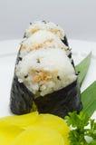 Vertikale mit drei nigiri Sushi Lizenzfreie Stockfotografie