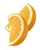 Vertikale mit 2 orange Viertelscheiben lokalisiert auf weißem Hintergrund Lizenzfreies Stockfoto