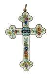 Vertikale Nahaufnahme eines alten Kreuzes mit einer handgemachten Blumenverzierung Lizenzfreie Stockfotos