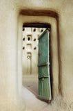 Vertikales Bild einer Tür in eine Dogon Schlammmoschee Lizenzfreie Stockfotografie