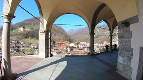 Vertova, Bergamo, Italy. The arcade of the Saint Maria Assunta Cathedral. Main church in the village stock footage