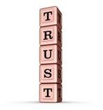Vertrauens-Wort-Zeichen Vertikaler Stapel von Rose Gold Metallic Toy Blocks Stockfoto