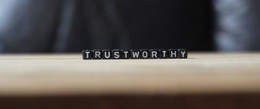 Vertrauenswürdiges Adjektivwort, wichtig Lizenzfreies Stockfoto