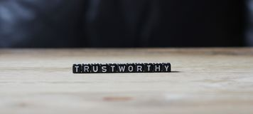 Vertrauenswürdiges Adjektivwort, wichtig Lizenzfreie Stockfotos