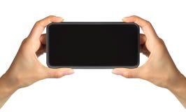 Vertretungsschwarzes Smartphone der Frauen Hand, Konzept des Nehmens des Fotos oder des selfie lizenzfreie stockbilder