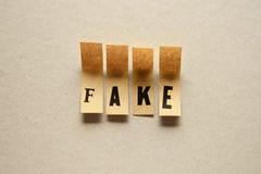 Vervalsing - woord in kleverige brieven stock foto's