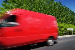 Vervoer met rode bestelwagen Stock Foto