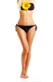 Vervollkommnen Sie den gebräunten lokalisierten Frauenkörper Stockbild