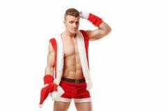 Verwarde die geschiktheid Santa Claus op witte achtergrond wordt geïsoleerd Royalty-vrije Stock Foto's