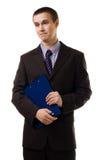 Verwarde jonge bedrijfsmensentribune in formeel kostuum Royalty-vrije Stock Fotografie