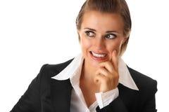 Verwarde moderne bedrijfs geïsoleerdei vrouw Stock Foto