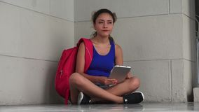 Verwarde Student Studying With Tablet stock video