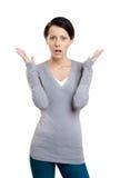 In verwarring gebrachte vrouw Stock Foto