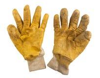 Verwendete Paare des Bearbeitens von gelben Handschuhen Stockbilder