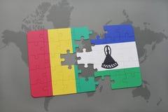 verwirren Sie mit der Staatsflagge der Guine und des Lesothos auf einer Weltkarte vektor abbildung