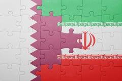 Verwirren Sie mit der Staatsflagge vom Iran und von Qatar Stockfotos