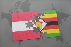 verwirren Sie mit der Staatsflagge von Österreich und von Simbabwe auf einem Weltkartehintergrund Lizenzfreies Stockfoto