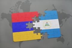 verwirren Sie mit der Staatsflagge von Armenien und von Nicaragua auf einer Weltkarte Lizenzfreies Stockbild
