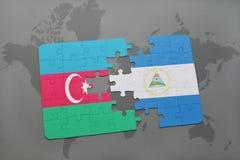 verwirren Sie mit der Staatsflagge von Azerbaijan und von Nicaragua auf einer Weltkarte Stockbild