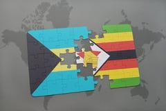 verwirren Sie mit der Staatsflagge von Bahamas und von Simbabwe auf einer Weltkarte Lizenzfreie Stockfotografie
