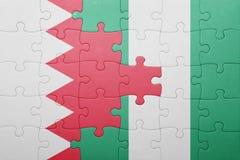 verwirren Sie mit der Staatsflagge von Bahrain und von Nigeria Lizenzfreie Stockbilder