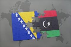 verwirren Sie mit der Staatsflagge von Bosnien und Herzegowina und von Libyen auf einer Weltkarte Stockfotografie
