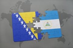 verwirren Sie mit der Staatsflagge von Bosnien und Herzegowina und von Nicaragua auf einer Weltkarte Stockbild