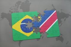 verwirren Sie mit der Staatsflagge von Brasilien und von Namibia auf einem Weltkartehintergrund Lizenzfreies Stockfoto
