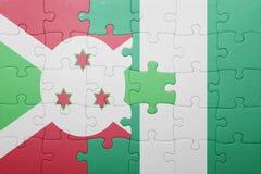 verwirren Sie mit der Staatsflagge von Burundi und von Nigeria Stockbild