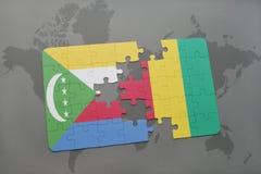 verwirren Sie mit der Staatsflagge von Comoren und von Guine auf einer Weltkarte vektor abbildung