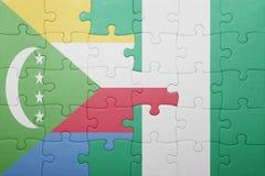 verwirren Sie mit der Staatsflagge von Comoren und von Nigeria Lizenzfreies Stockfoto
