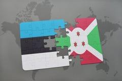 verwirren Sie mit der Staatsflagge von Estland und von Burundi auf einer Weltkarte Lizenzfreies Stockfoto