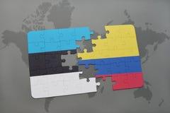verwirren Sie mit der Staatsflagge von Estland und von Kolumbien auf einer Weltkarte Lizenzfreies Stockfoto