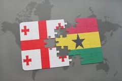 verwirren Sie mit der Staatsflagge von Georgia und von Ghana auf einer Weltkarte Lizenzfreie Stockfotografie