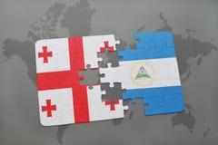 verwirren Sie mit der Staatsflagge von Georgia und von Nicaragua auf einer Weltkarte Stockfotos