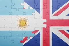 Verwirren Sie mit der Staatsflagge von Großbritannien und von Argentinien Stockfoto