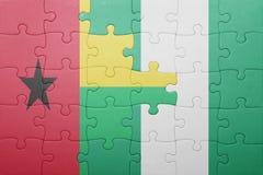 verwirren Sie mit der Staatsflagge von Guinea-Bissau und von Nigeria Stockfotografie